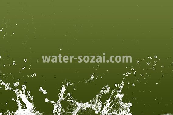緑背景の水飛沫が上がる写真・フォト