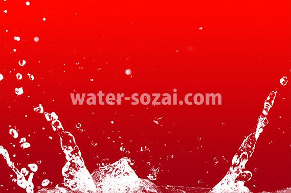 赤背景の水飛沫が上がる写真・フォト