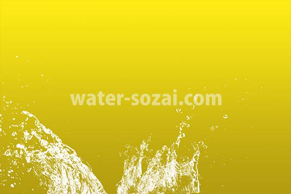黄色背景の水飛沫が上がる写真・フォト