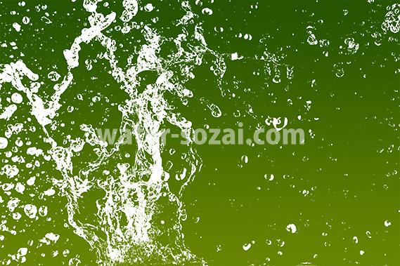 緑色背景の水が注がれて跳ねる写真・フォト